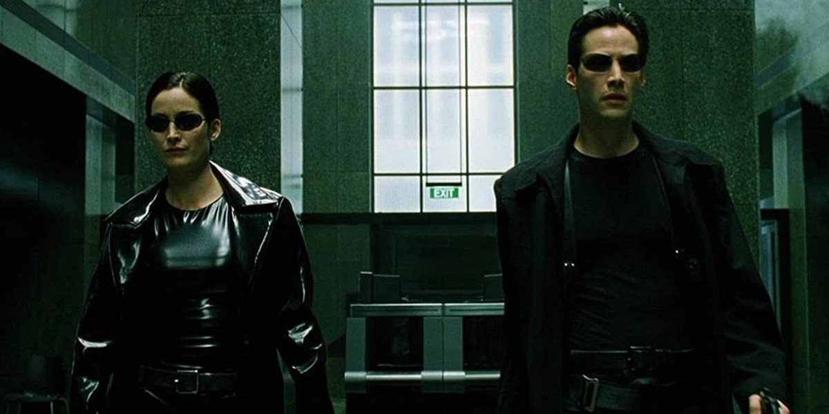 Carrie-Ann Moss as Trinity as Keanu Reeves as Neo in The Matrix (1999)