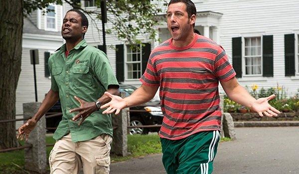 Grown Ups 2 Chris Rock Adam Sandler running down the street in a panic