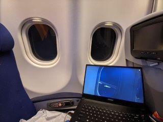 Rami Ismail playing Microsoft Flight Simulator on a flight.