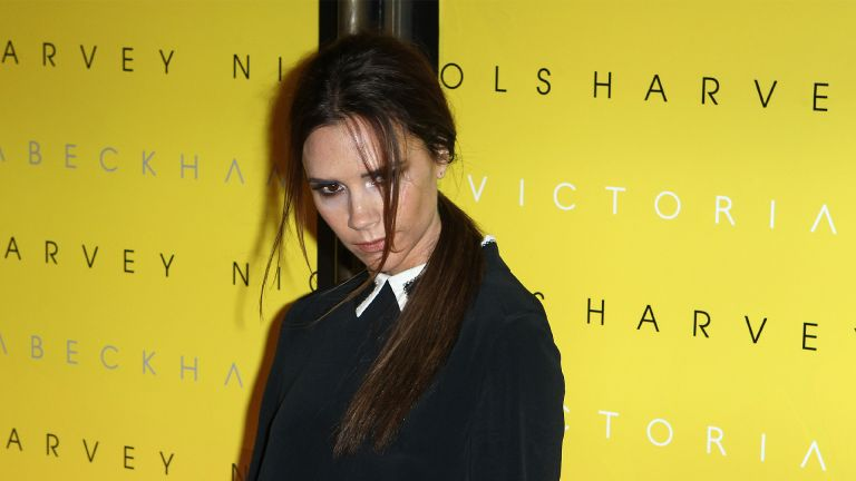 LONDON, UNITED KINGDOM - FEBRUARY 17: Victoria Beckham poses for cameras to toast her collection launch at Harvey Nichols on February 17, 2012 in London, United Kingdom. (Photo by Fred Duval/FilmMagic)