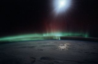 Solar wind particles generate the aurora phenomena in the Earth's atmosphere.
