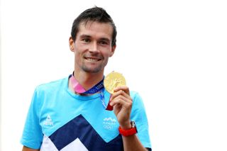 Primoz Roglic (Slovenia) with the Olympic gold medal for the time trial