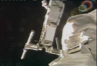 Spacewalkers Help Detach Space Station Solar Power Tower