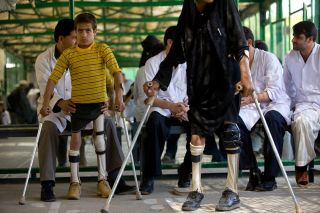 Polio survivors test out new pairs of leg braces at an orthopedic clinic in Afghanistan in September, 2009. Afghanistan is one of the few countries still dealing with the disease.