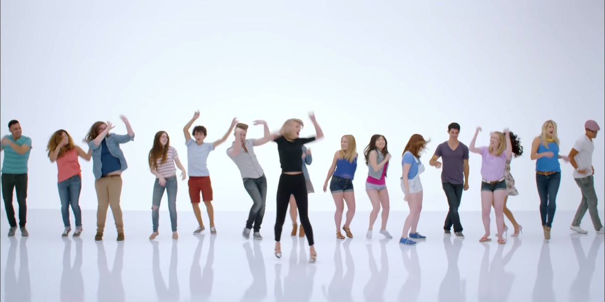 Taylor Swift dancing with fans in Shake It Off music video