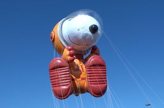 Astronaut Snoopy lifts off for a test flight prior to the 93rd Macy's Thanksgiving Day Parade in New York City. A forecast for strong winds threatens to ground the NASA-inspired balloon.