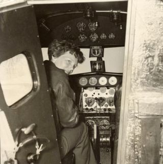 Amelia Earhart in the Electra cockpit, c.1936.