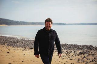 A beach stroll in 'Wonderful Wales With Michael Ball'.