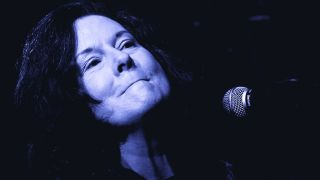 Linda Gail Lewis, mid-song, in front of a microphone.