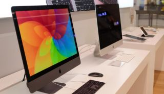 Two iMac models on sale in a retail store.