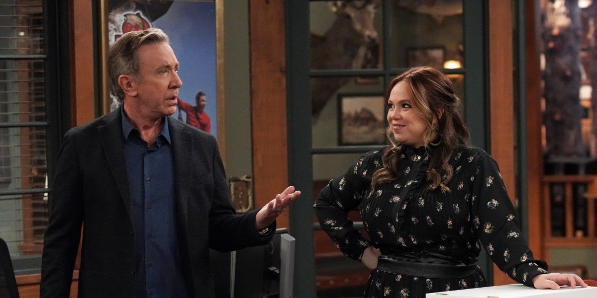 mike and kristin in mike's outdoor man office on last man standing