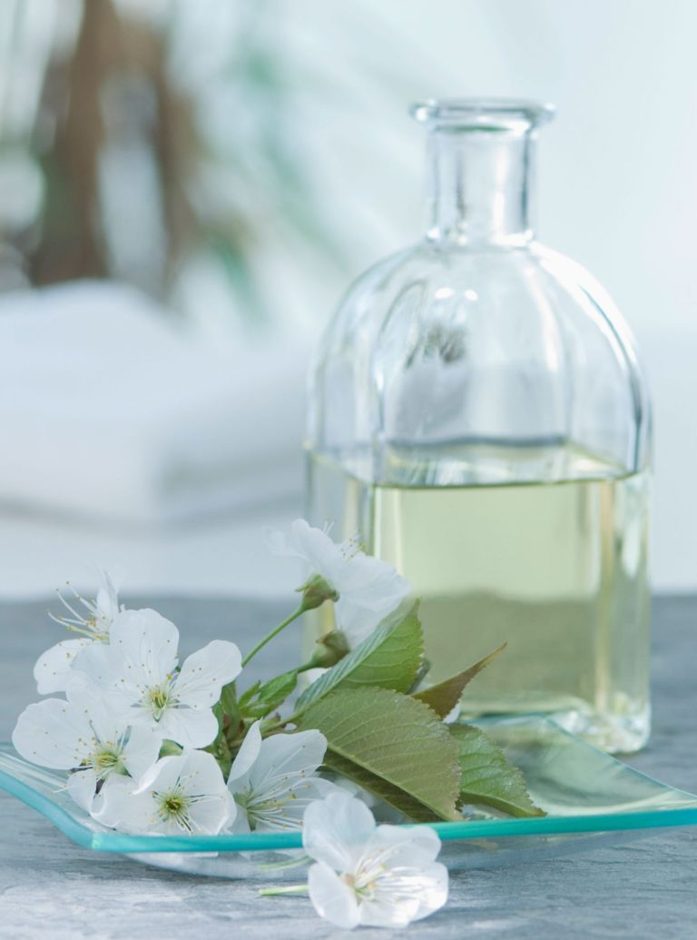 Photo: Body oil and flowers