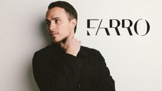 Josh Farro standing in front of a plain white wall