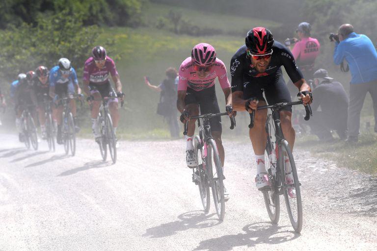 Filippo Ganna leading Egan Bernal on the gravel at the Giro d'Italia 2021