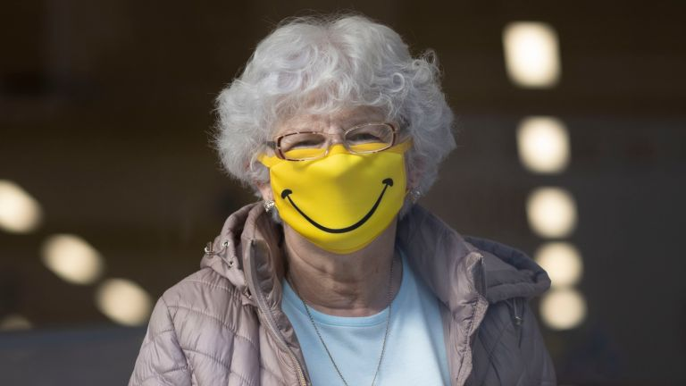 BARRY, WALES - OCTOBER 01: A woman smiles while wearing a novelty face mask in a shop on October 1, 2020 in Barry, Wales. Six more people have died in Wales after testing positive for Covid-19, the most reported in a single day since July 2. Public Health Wales (PHW) also confirmed there were 398 new lab-confirmed positive cases of coronavirus for Thursday, October 1. The highest figure so far during the second wave. More cases were only reported once before on April 10. (Photo by Matthew Horwood/Getty Images)