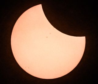 As the moon began to eclipse the sun on Aug. 21, 2017, a few sunspots were visible on the solar surface.