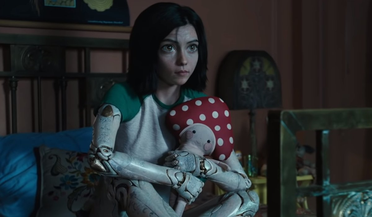 Alita: Battle Angel Alita clutching a stuffed animal