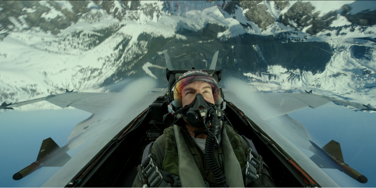 Tom Cruise as Maverick performing an over-the-top plane stunt in Top Gun: Maverick