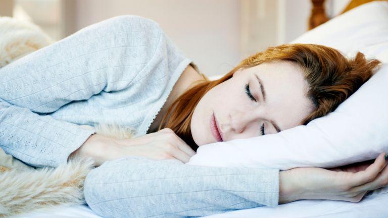 woman lying asleep in bed