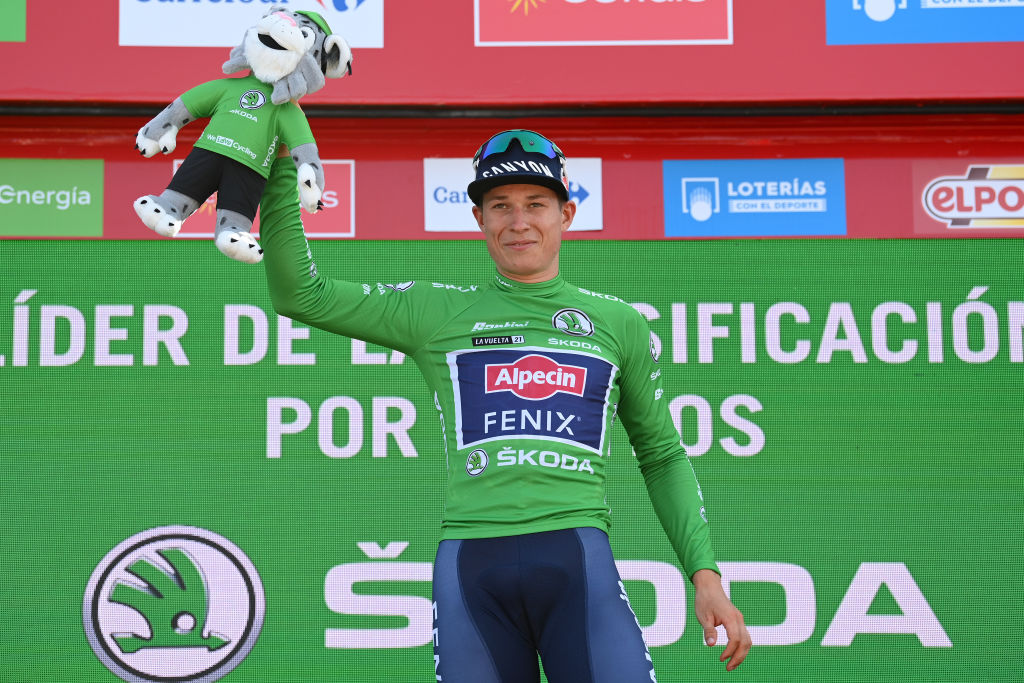 ALTO DE LA MONTAA DE CULLERA SPAIN AUGUST 19 Jasper Philipsen of Belgium and Team AlpecinFenix celebrates winning the Green Points Jersey on the podium ceremony after the 76th Tour of Spain 2021 Stage 6 a 1583km stage from Requena to Alto de la Montaa de Cullera 184m lavuelta LaVuelta21 on August 19 2021 in Alto de la Montaa de Cullera Spain Photo by Stuart FranklinGetty Images