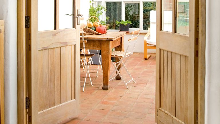how to lime wood: limed wood doors opening to a garden room