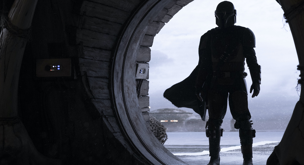 The Mandalorian standing in silhouette