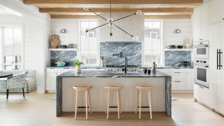 An example of white kitchen backsplash ideas with green marble backsplash and island countertop