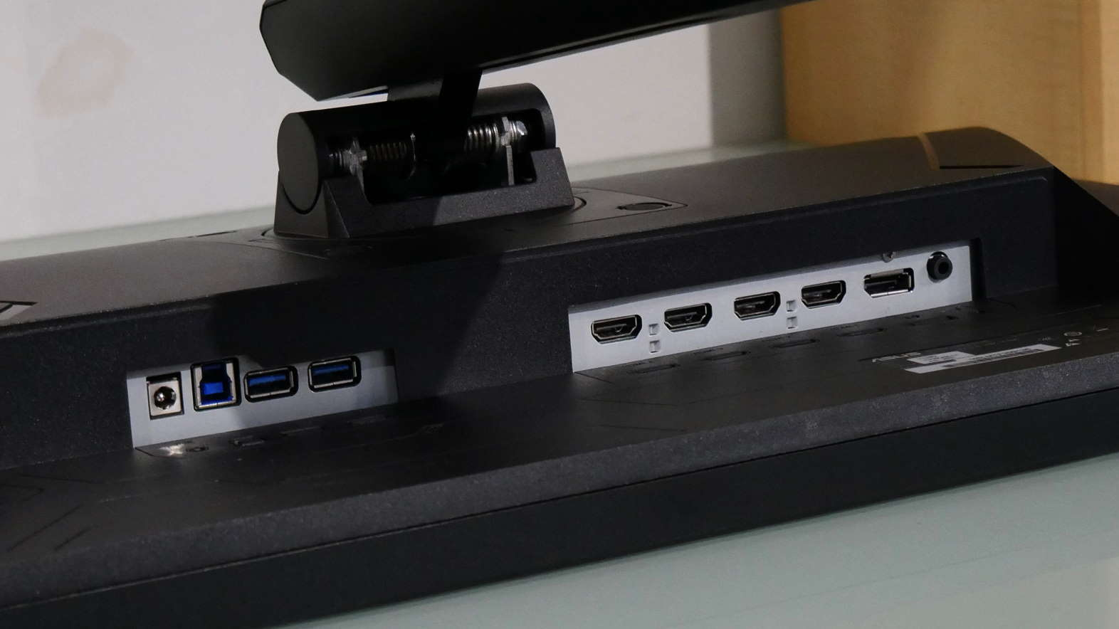 Asus TUF VG28UQL1A gaming monitor lying on its front to display the ports
