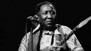Muddy Waters playing the guitar