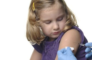 A young girl receives a vaccination.