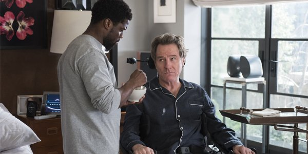 Kevin Hart and Bryan Cranston during feeding time in The Upside