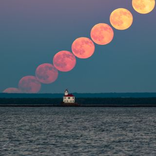 A series of shots of the full moon on June 20, 2016, taken from Duluth, Minnesota's Park Point beach. The Superior Entry Lighthouse can be seen in the foreground. The photo was sent in by photographer Grant Johnson.