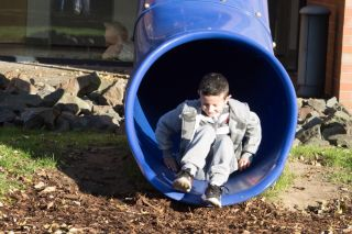 After receiving his new skin, the boy plays on the grounds of the hospital in Bochum, Germany.