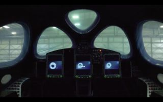 A still from a new video showing the lights coming on inside Virgin Galactic's third SpaceShipTwo vehicle.