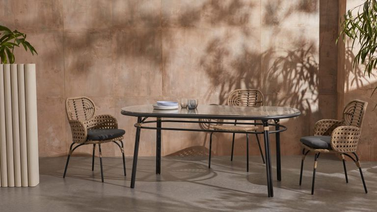 Made garden table, Swara Garden Oval Dining Table in garden with chairs around it