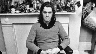 A portrait of John Wetton
