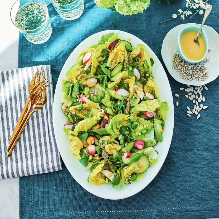 Spring salad recipe laid out on a plate in the sunshine