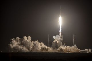 After its June 30, 2021 launch, SpaceX paused Starlink liftoffs to add lasers to the satellites. In this photo, a SpaceX Falcon 9 rocket blasted off from Florida on Feb. 15, 2021, during a successful Starlink launch.