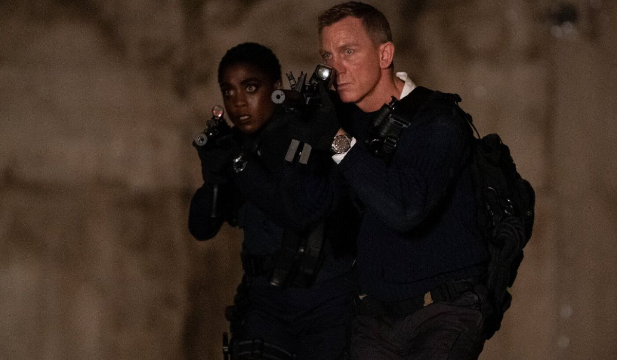 No Time To Die Lashana Lynch and Daniel Craig storm in with rifles drawn