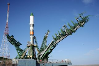 A Russian Soyuz rocket and its unmanned Progress 63P supply ship stand atop their launchpad at Baikonur Cosmodrome, Kazakhstan ahead of a March 31, 2016 launch to the International Space Station. The Progress vehicle is carrying 3 tons of supplies for the