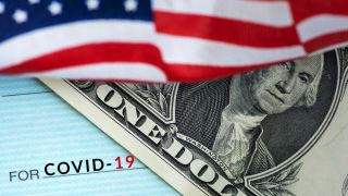 A stimulus check overlaid by a dollar bill and a fragment of an American flag.