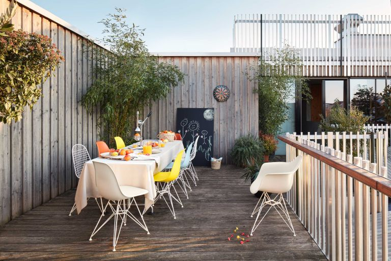 eames plastic chairs on decking from vitra