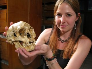 Alice Roberts, of the University of Birmingham, holds the skull of a hobbit, or <em>Homo floresiensis</em>.