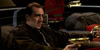 Nicolas Cage with golden guns in