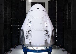 SpaceX and Space Adventures have signed a deal to launch up to four passengers into Earth orbit on a Crew Dragon spacecraft like the one seen here. This Crew Dragon will launch NASA astronauts to the International Space Station in 2020.
