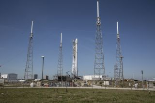 A SpaceX Falcon 9 rocket and Dragon cargo ship stand atop Space Launch Complex 40 at the Cape Canaveral Air Force Station, Florida in this file photo. SpaceX has delayed its next Falcon 9 launch from SLC-40 to no earlier than Dec. 13, 2017.