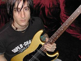 GN'R guitarist Fortus says he was 'misquoted,' and you can quote us on that