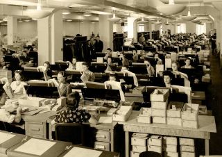 1940 census workers transferring data to punch cards.