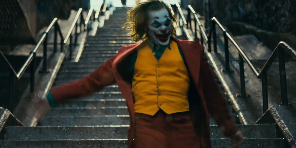 Joker dances on the stairs