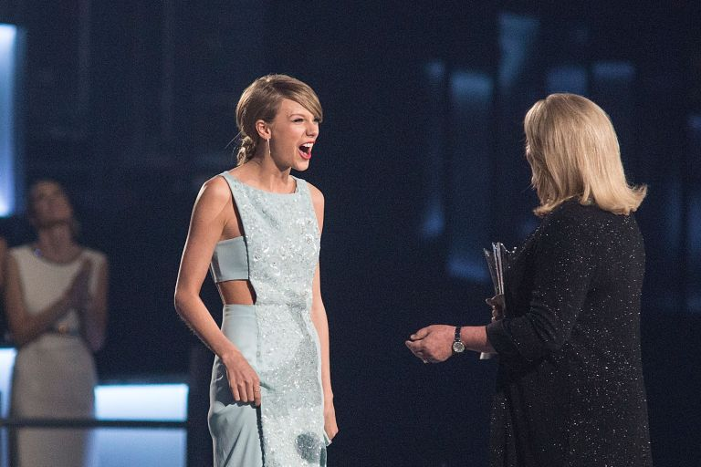 Taylor Swift onstage with Andrea Swift